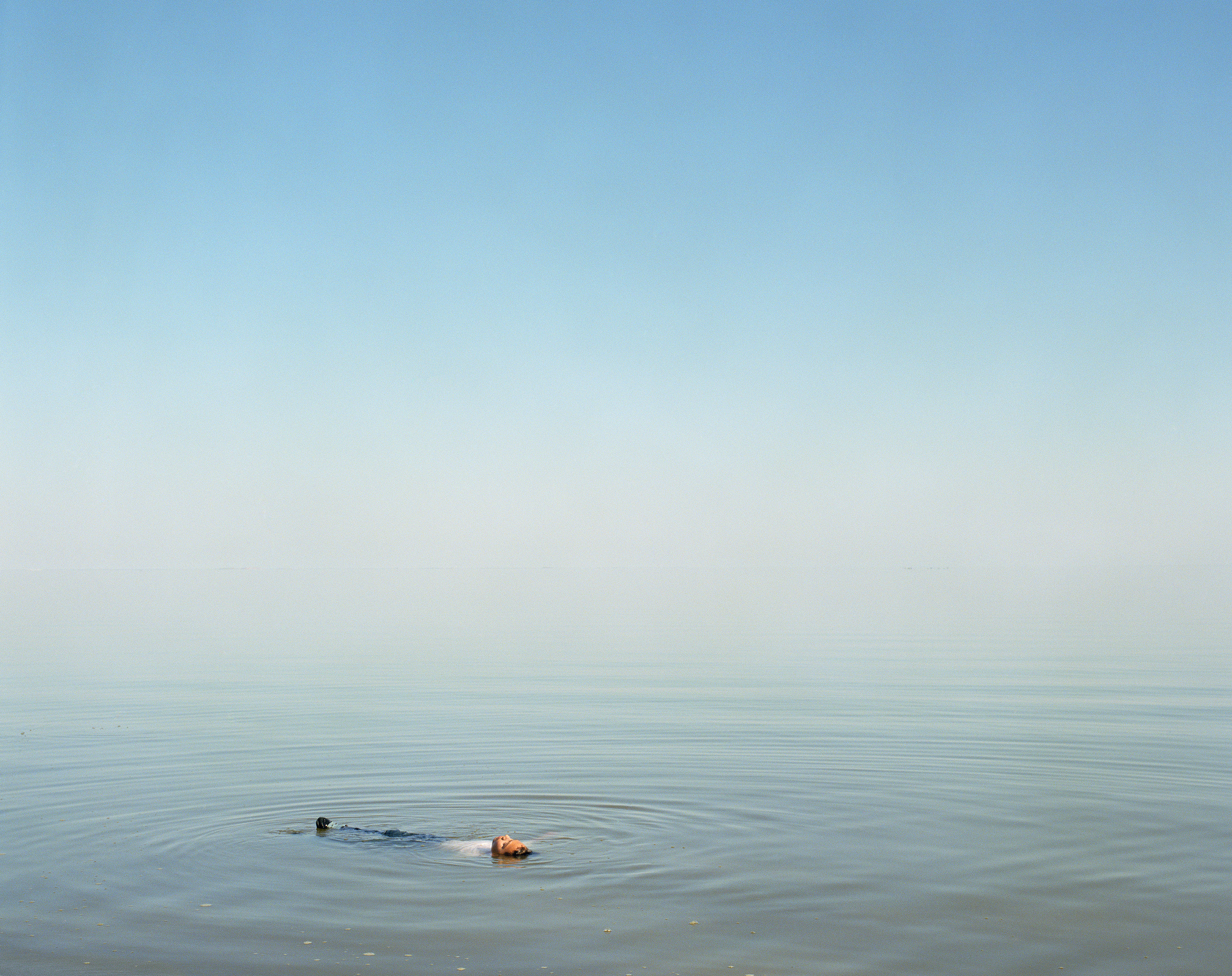 "Ron Jude, 'Boy Floating in Water', 2012, from the series ""Lago"", Archival Pigment Print, 90 x 112 cm"